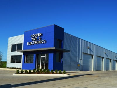 Cooper Tint & Electronics finished metal building exterior.